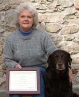 Poppy with her  Mom and CGC certificate